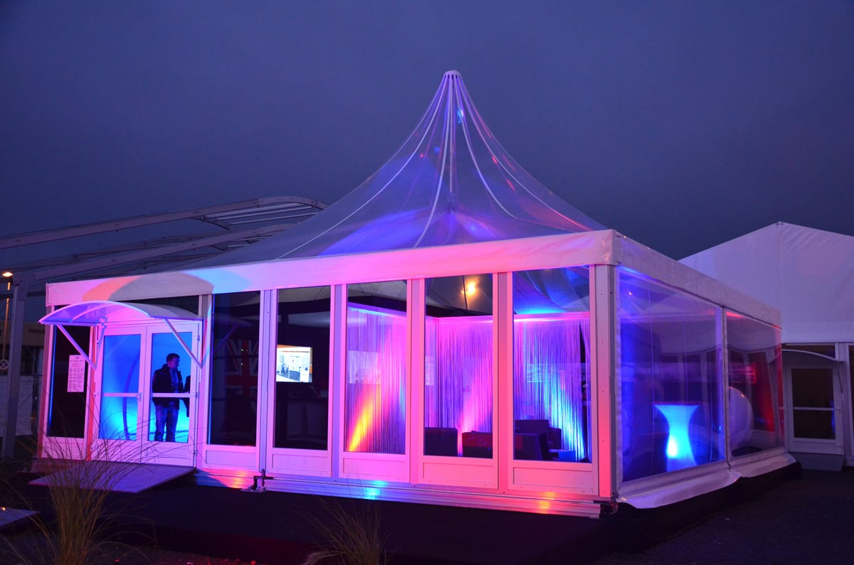 A Pagoda marquee lit up at a trade show event