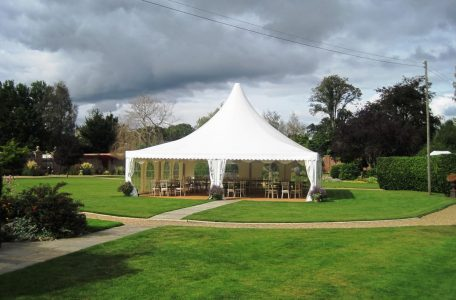 A Large pagoda marquee providing a hospitality space in garden