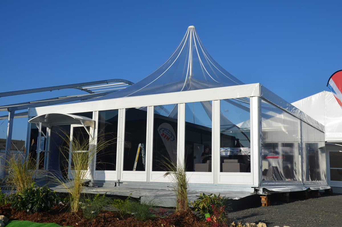 A Pagoda Marquee with a Scalloped Edge Roof Valance at a trade show