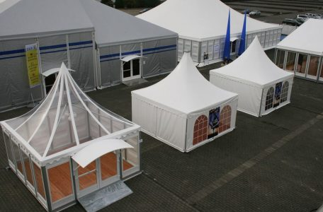 Multiple Pagoda Marquees with Scalloped Edge Roofs on display at an event show