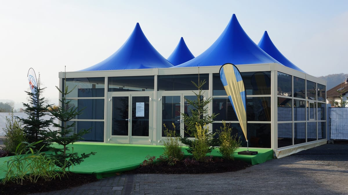 An Avantgarde Pagoda with a blue Scalloped Edge Roof at a trade show