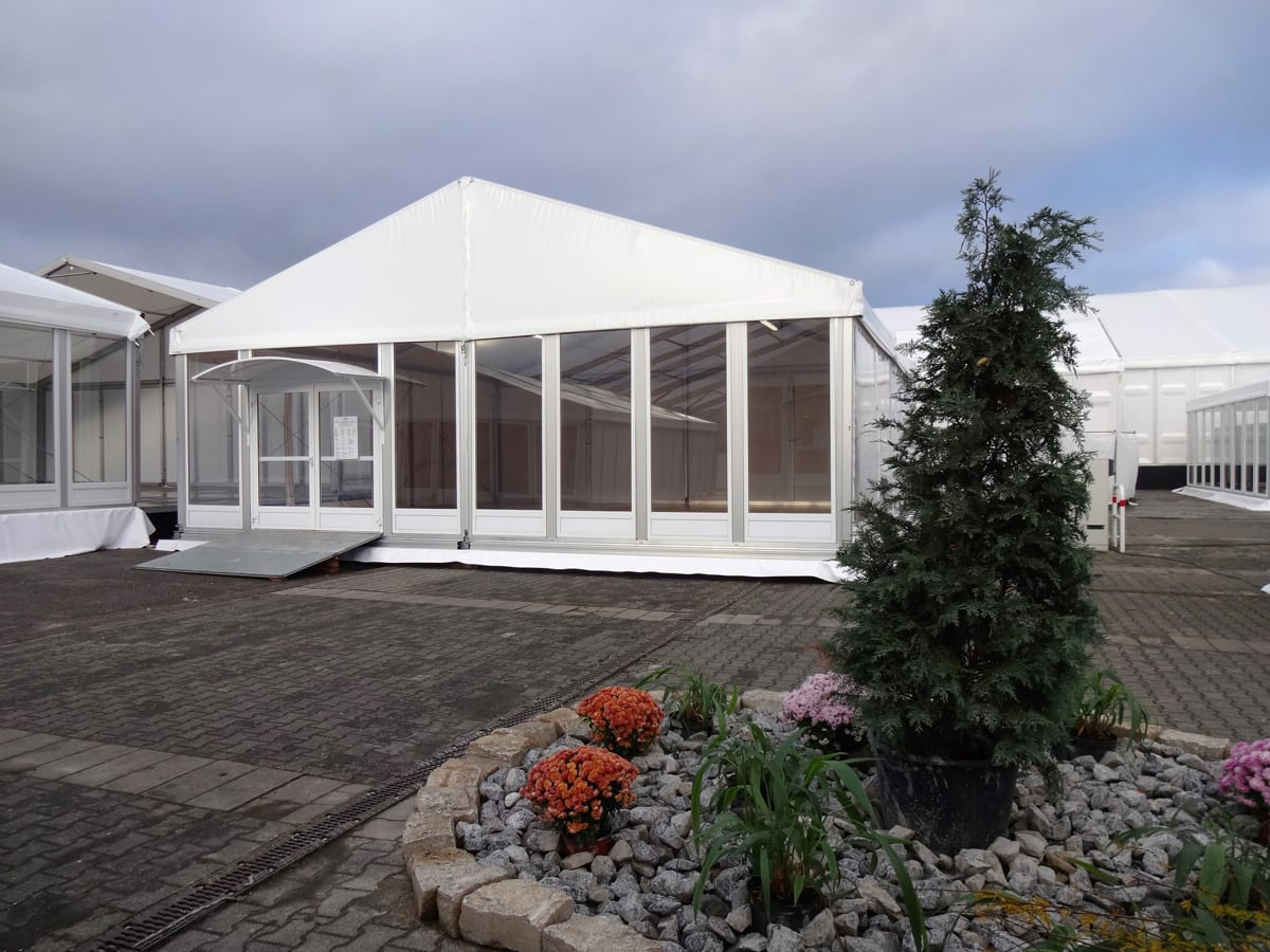 A large temporary complete tent in high gloss white