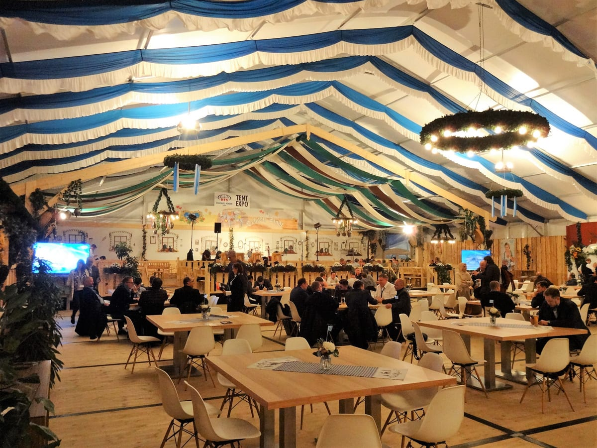 The interior of a HTS tentiQ GZ large event tent providing hospitality for a trade show