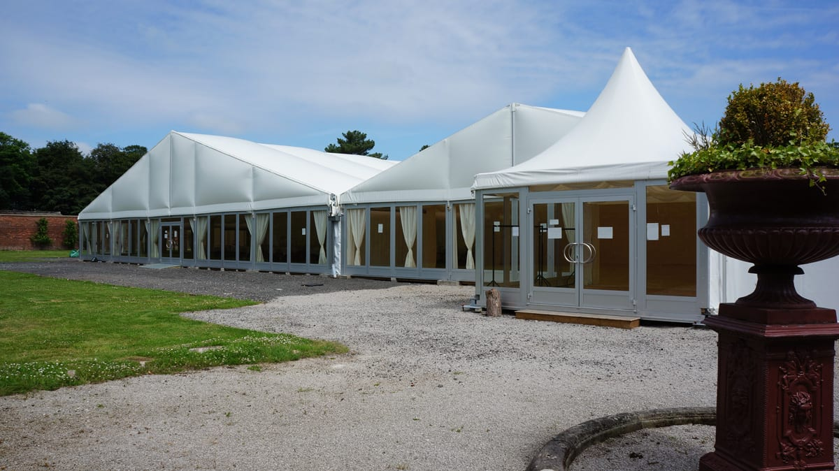 A HTS tentiQ GZ A-frame tents side by side being used for a hospitality event