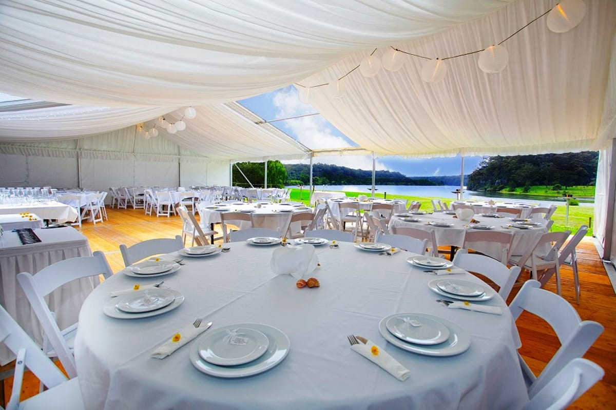 The interior of a HÖCKER P Series event marquee set up for a wedding