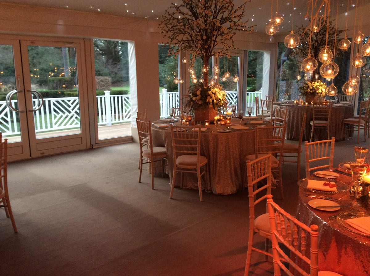 The interior of a HÖCKER P Series event marquee for a wedding with an exterior balcony
