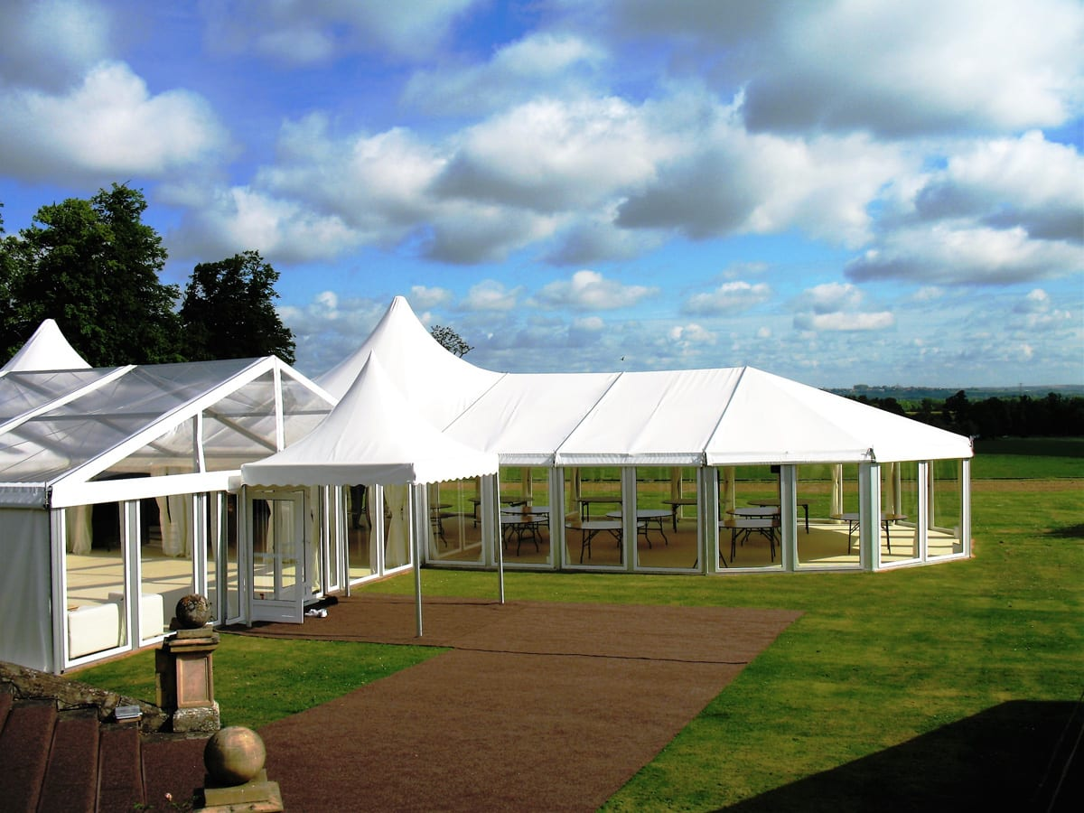 A HÖCKER P Series a-frame marquee with a poly-glass roof and a high peak marquee extension for use at functions
