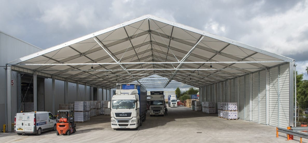 A Large Industrial canopy Building being used for lorry deliveries