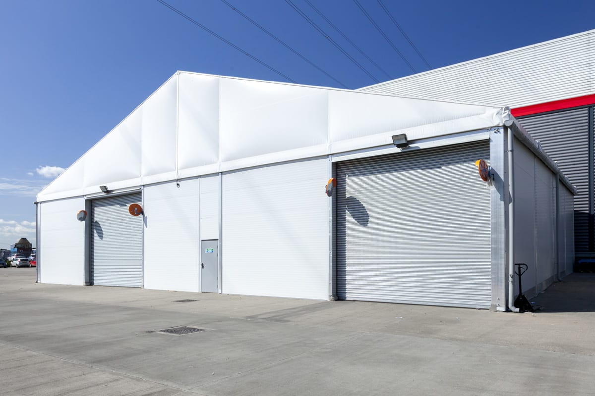 A Industrial warehouse with two roller shutter doors