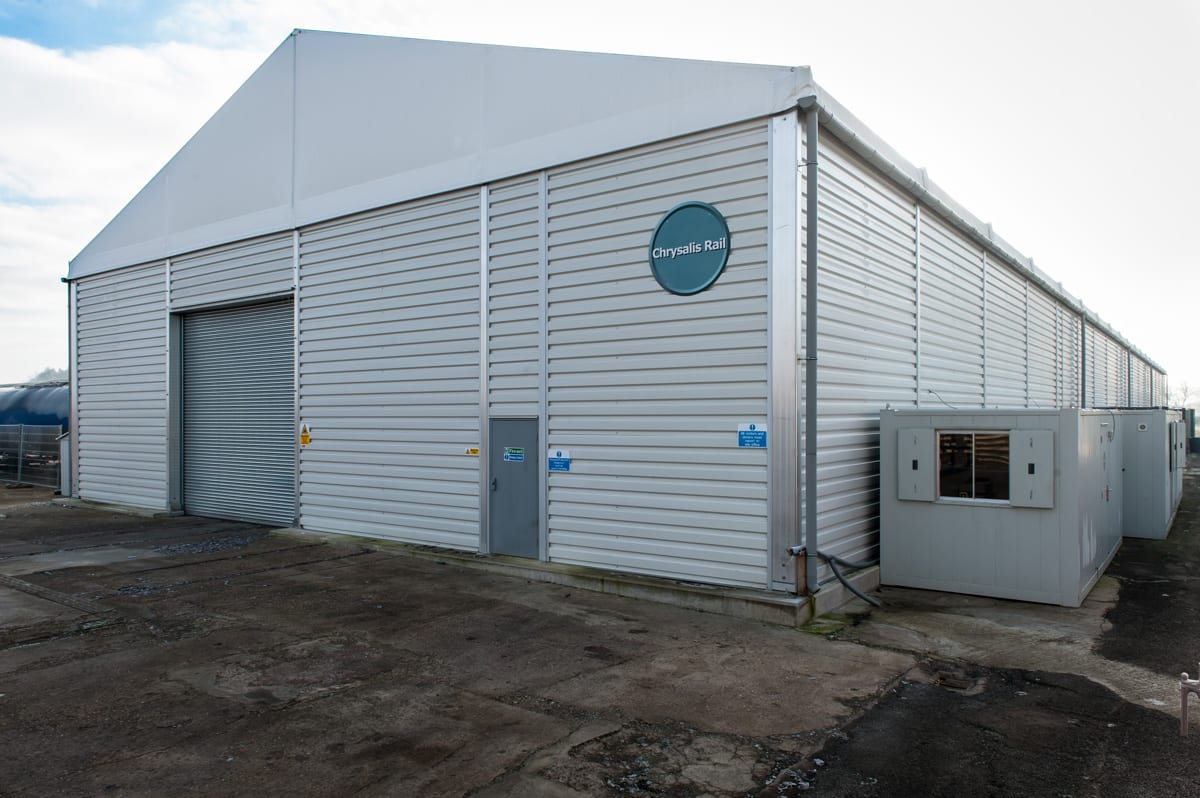 A Large industrial warehouse building with roller shutter doors