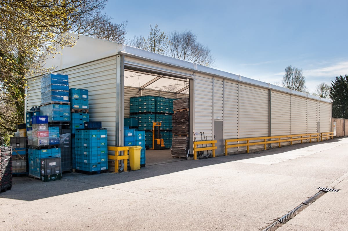 An Industrial warehouse with roller shutter doors for storage