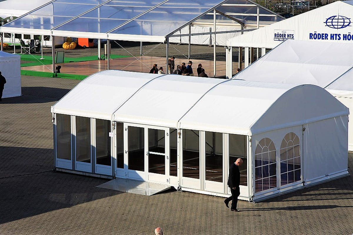 A RÖDER HTS (PZ) curved roof small party tent at a trade show