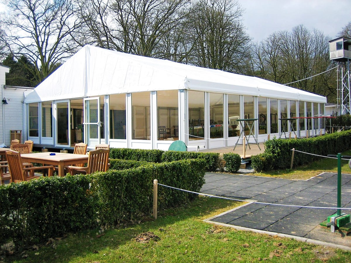 A RÖDER HTS (PZ) A-frame small party tent being used for a function with an outside seating area