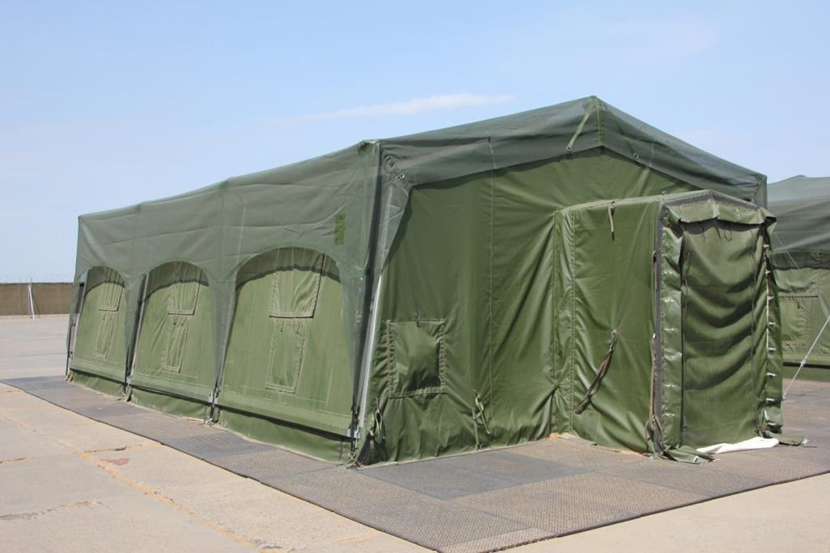 A green Rapid Deployment tent providing military shelter