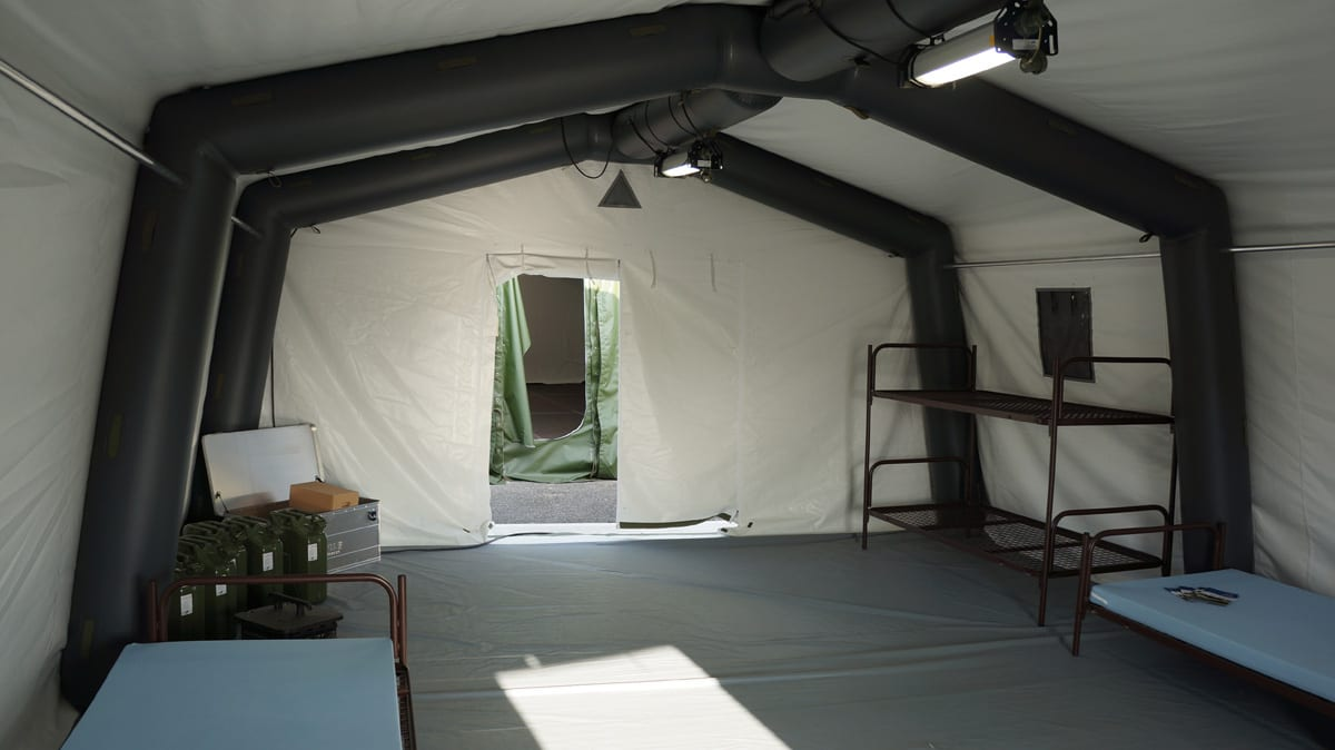 The interior of an inflatable shelter providing military troop accommodation