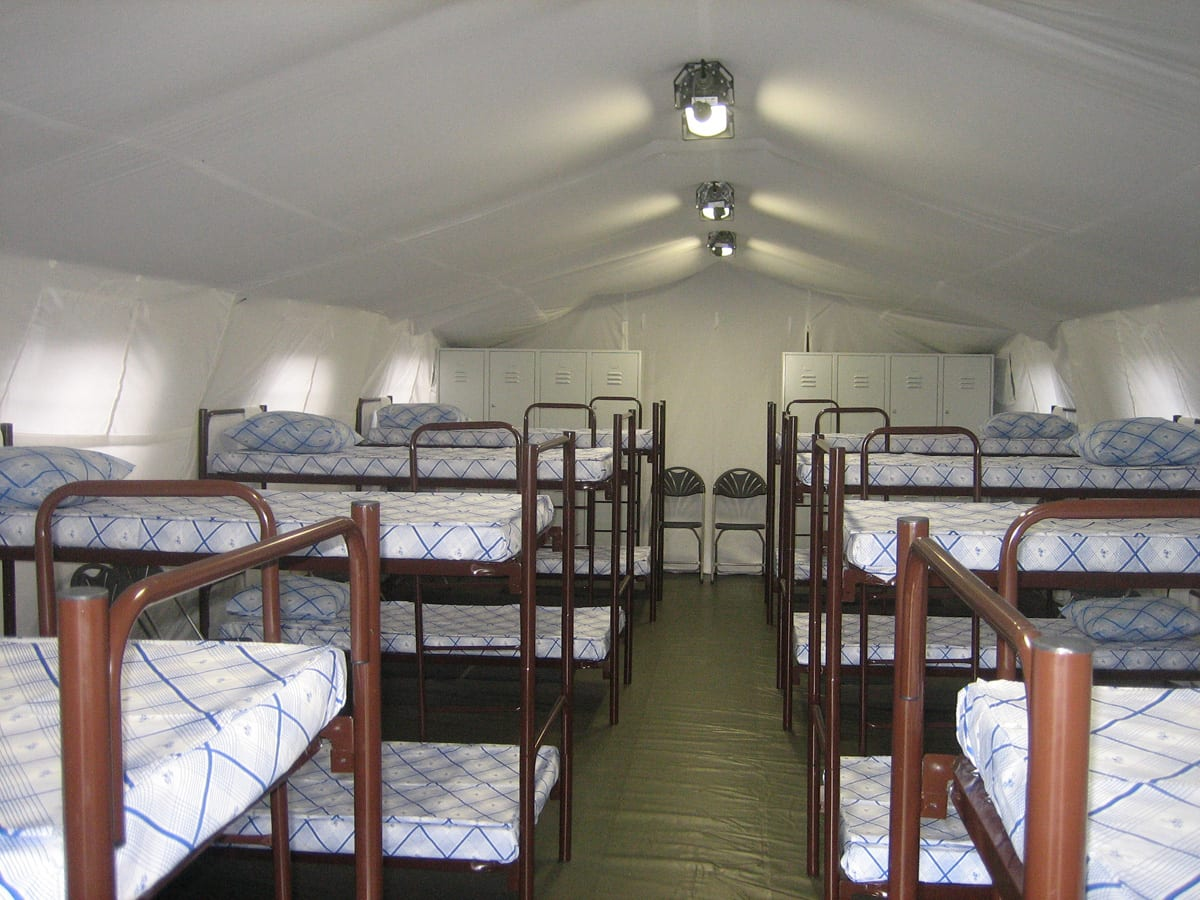 A Rapid deployment shelter containing bunk beds providing military accommodation