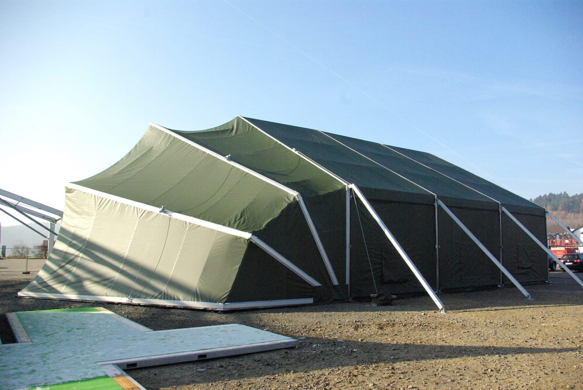 A Rapid deployment shelter with a unique curved edge wall