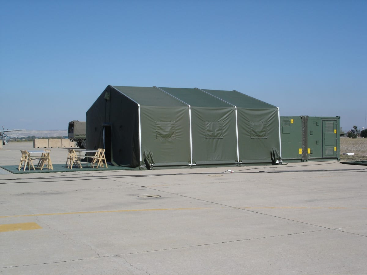 A Rapid Deployment Shelter used for emergency relief with an outside seating area