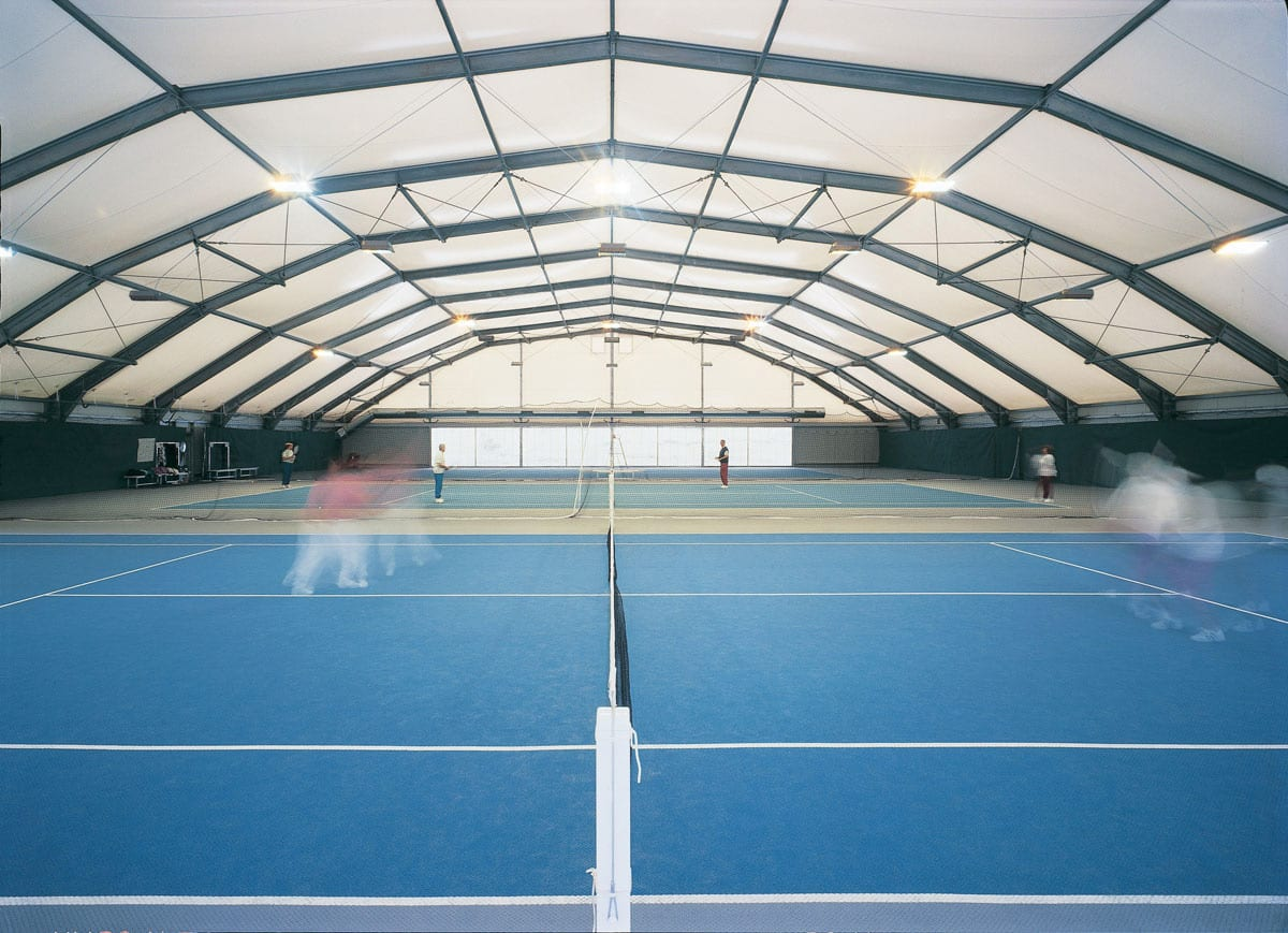 A Large sports structure used to provide a racket court cover