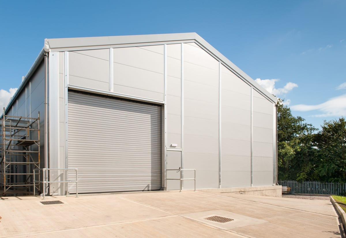 A Large steel roof building with roller shutter doors