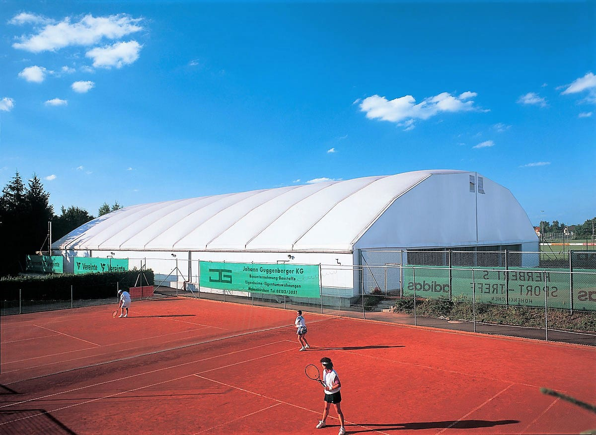 A Medium sports structure to cover a clay tennis court
