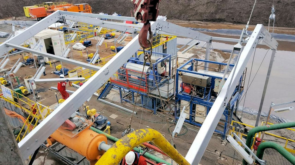 Weather protection structures built around drilling equipment